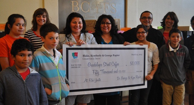 "Photo: Coffee house staff and kids pose with the ""big check"""