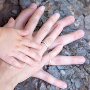 Photo: Child and parents' hands