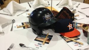 Photo: Helmet and baseball cap used for table centerpiece