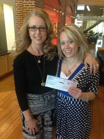 Photo: Holly Betenbough presents Kami Jackson with check