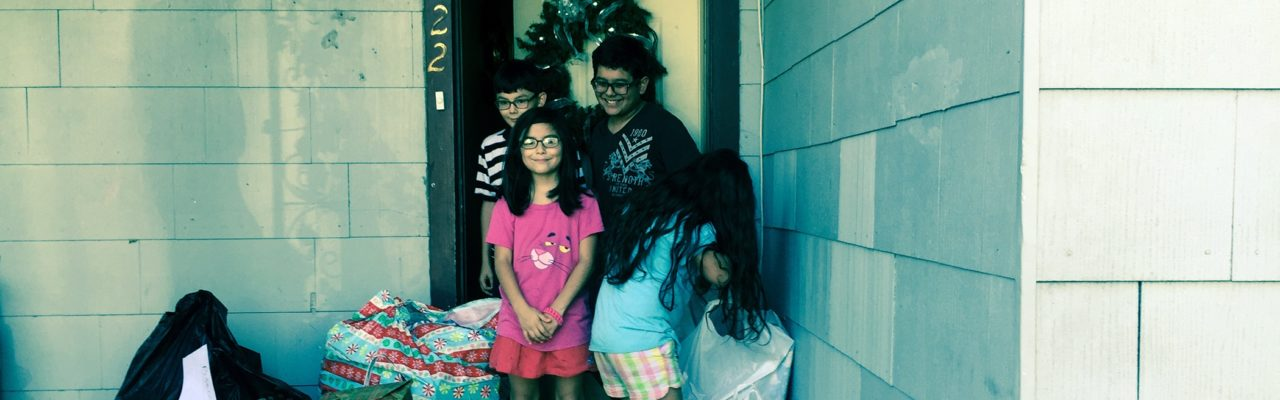 Photo: Kids by front door with presents and supplies