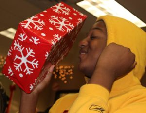 Photo: An excited young adult with a present