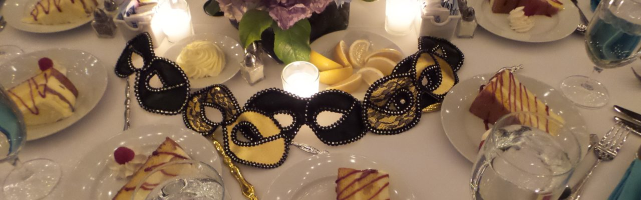 Photo: Deserts and masquerad masks on table