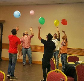 Photo: Participants play the balloon game at MOVE in McAllen Conference