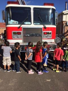 Photo: Students Line up in front of a Fire Engine