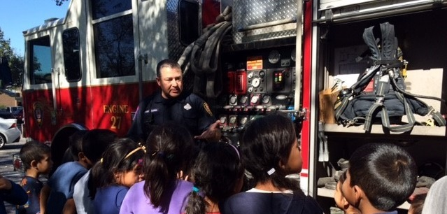 Photo: Firefighter speaks to ICS kids