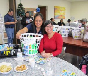 Photo: BCFS Staff Member with Loteria Event Participant