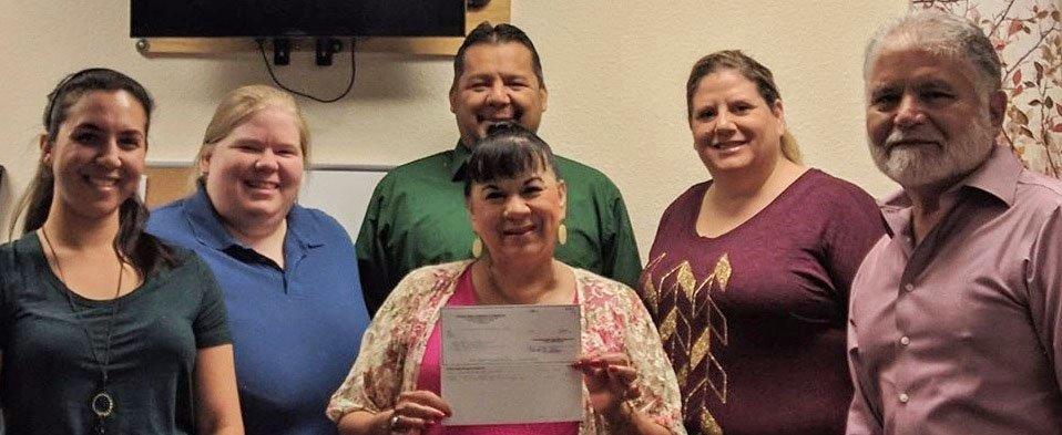 Photo: BCFS Corpus Christi Staff Accepting Grant Award