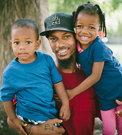 Photo: Father with two children