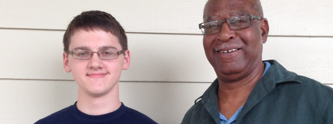 Photo: Isaac with BCFS Staff Member