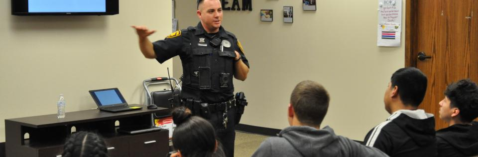 Photo: A Police Officer speaks at Drug and Alcohol Awareness Event