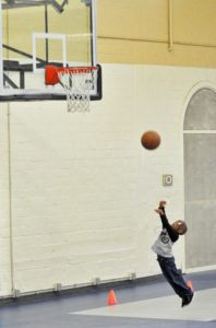 Photo: Boy shooting hoops
