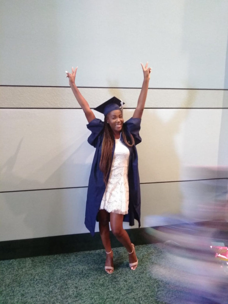 Latika celebrating her graduation