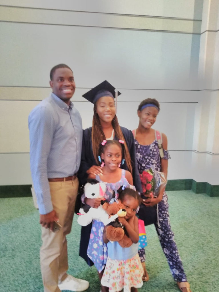 Latika and her family during graduation